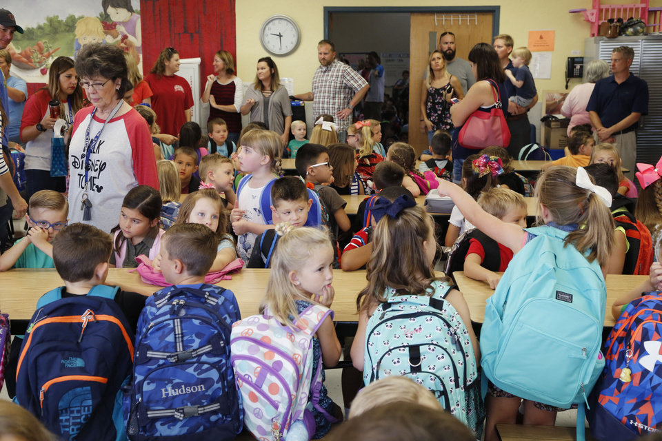 Photo -  Kindergartners and parents gather together during the first day of school at Deer Creek school district's Prairie Vale Elementary School. [PHOTO BY PAUL HELLSTERN, THE OKLAHOMAN]