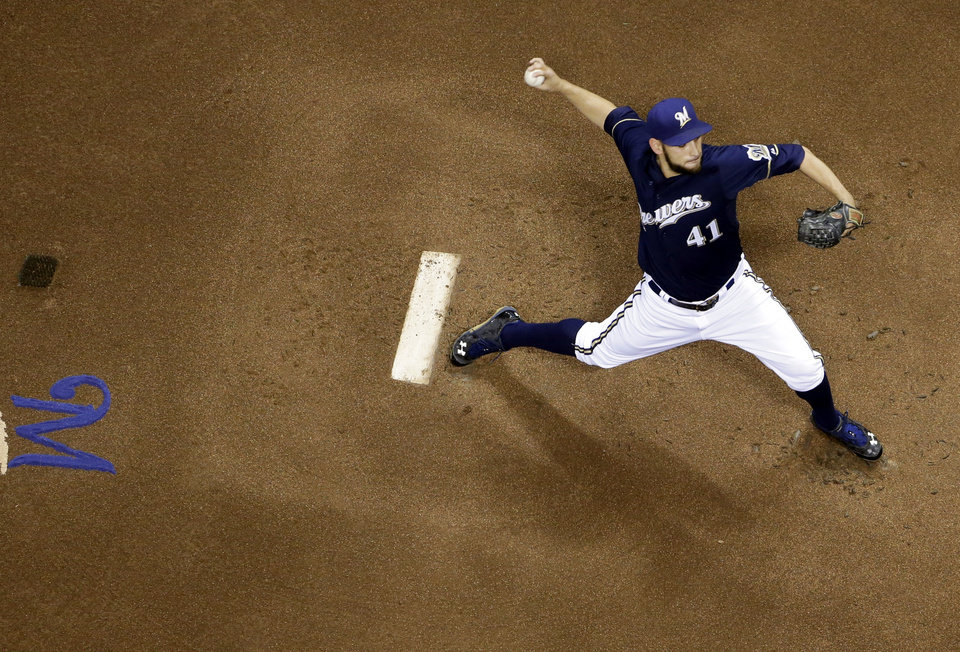 Photo - Milwaukee Brewers starting pitcher Marco Estrada throws during the first inning of a baseball game against the Pittsburgh Pirates, Tuesday, May 13, 2014, in Milwaukee. (AP Photo/Morry Gash)