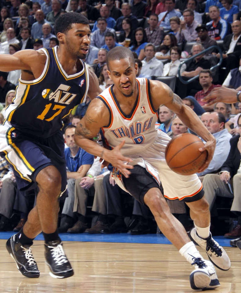 Photo - Oklahoma City's Eric Maynor (6) drives past Utah's Ronnie Price (17)during the NBA game between the Oklahoma City Thunder and Utah Jazz, Wednesday, March 23, 2011, at the Oklahoma City Arena. Photo by Sarah Phipps, The Oklahoman