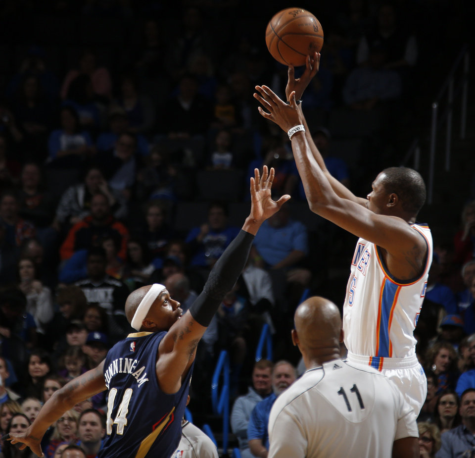 Photo - Oklahoma City's Kevin Durant (35) shoots over New Orleans' Dante Cunningham (44) during an NBA game between the Oklahoma City Thunder and the New Orleans Pelicans at Chesapeake Energy Arena on Friday, Feb. 6, 2015. Photo by Bryan Terry, The Oklahoman