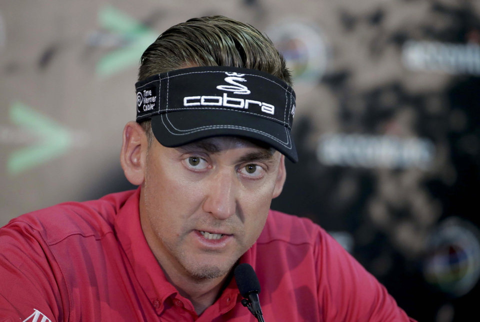 Photo - Ian Poulter, of England, answers questions during a news conference for the Match Play Championship golf tournament Tuesday, Feb. 18, 2014, in Marana, Ariz. (AP Photo/Chris Carlson)