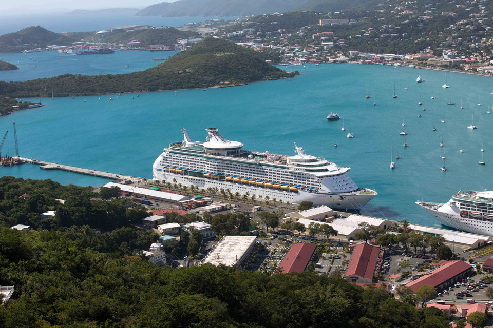 Photo - The Royal Caribbean International's Explorer of the Seas is docked at Charlotte Amalie Harbor in St. Thomas, U. S. Virgin Islands, Sunday, Jan. 26, 2014. U.S. health officials have boarded the cruise liner to investigate an illness outbreak that has stricken at least 300 people with gastrointestinal symptoms including vomiting and diarrhea. (AP Photo/Thomas Layer)