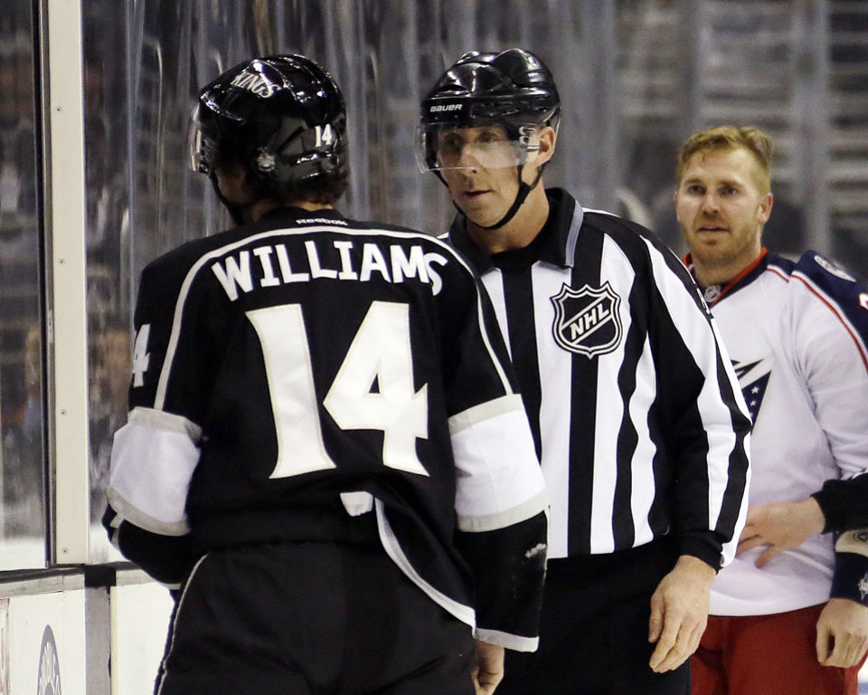 Los Angeles Kings right wing Justin Williams (14) and Columbus Blue Jackets defenseman James Wisniewski, right, continue to challenge each other as both head for the penalty box for roughing in the first period of an NHL hockey game in Los Angeles, Thursday, April 18, 2013. (AP Photo/Reed Saxon)
