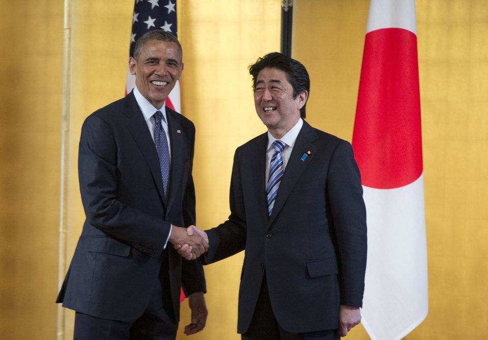 Photo - President Barack Obama, left, and Japanese Prime Minister Shinzo Abe shake hands as they arrive to participate in a bilateral meeting at the Akasaka State Guest House in Tokyo, Thursday, April 24, 2014.  Facing fresh questions about his commitment to Asia, Obama will seek to convince Japan's leaders Thursday that he can deliver on his security and economic pledges, even as the crisis in Ukraine demands U.S. attention and resources elsewhere.  (AP Photo/Carolyn Kaster)