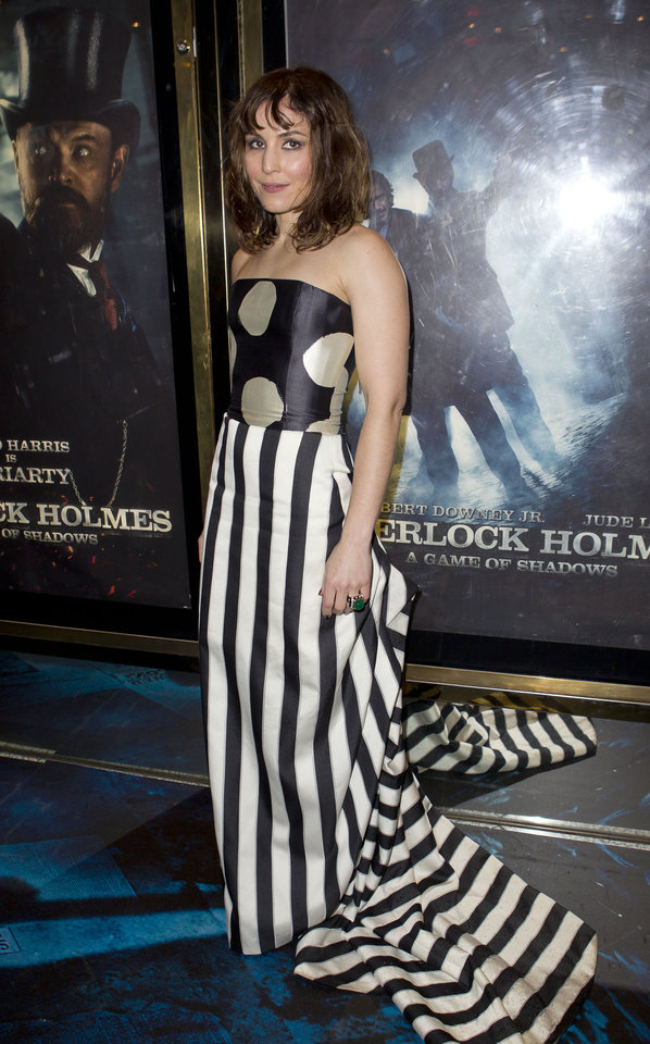 Actress Noomi Rapace arrives for the European Premiere of Sherlock Holmes: A Game of Shadows, a filmed directed by Guy Ritchie, at a central London cinema, London, Thursday, Dec. 8, 2011. (AP Photo/Joel Ryan) ORG XMIT: LENT112