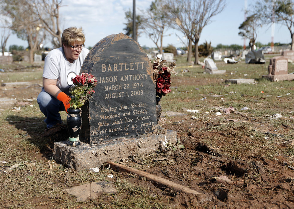 Toni Allison pauses as she cleans her nephew\'s grave stoneup a cemetery in Moore, Okla., Wednesday, May 22, 2013. Photo by Sarah Phipps, The Oklahoman