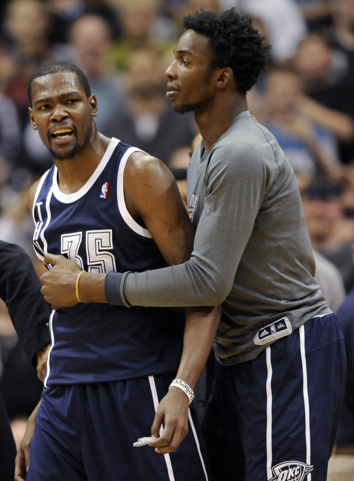 Oklahoma City Thunder\'s Hasheem Thabeet, right, of Tanzania, holds back small forward Kevin Durant (35) after Durant was called for a technical foul during the fourth quarter of an NBA basketball game against the Minnesota Timberwolves at the Target Center on Thursday, Dec. 20, 2012, in Minneapolis. The Timberwolves won 99-93. (AP Photo/Hannah Foslien) ORG XMIT: MNHF110