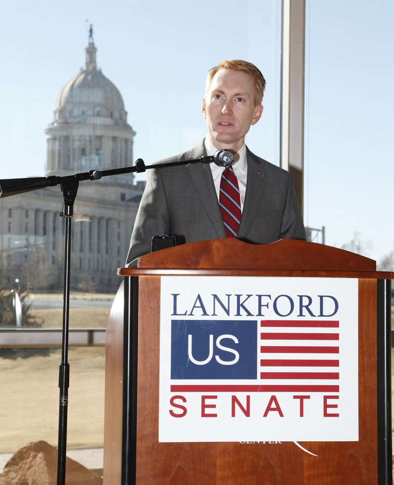 Photo - Oklahoma U.S. Rep. James Lankford announces his run for the Senate seat being vacated by Sen. Tom Coburn, during a press conference at the Oklahoma History Center in Oklahoma City on Monday.  Photo by Paul Hellstern, The Oklahoman  PAUL HELLSTERN