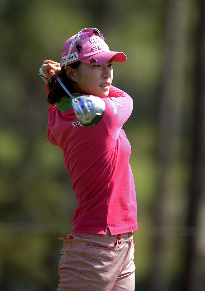Photo - Hee Young Park, of South Korea, watches the flight of her tee shot on the ninth hole in the second round of the Airbus LPGA Classic golf tournament at Magnolia Grove on Friday, May 23, 2014, in Mobile, Ala. (AP Photo/G.M. Andrews)
