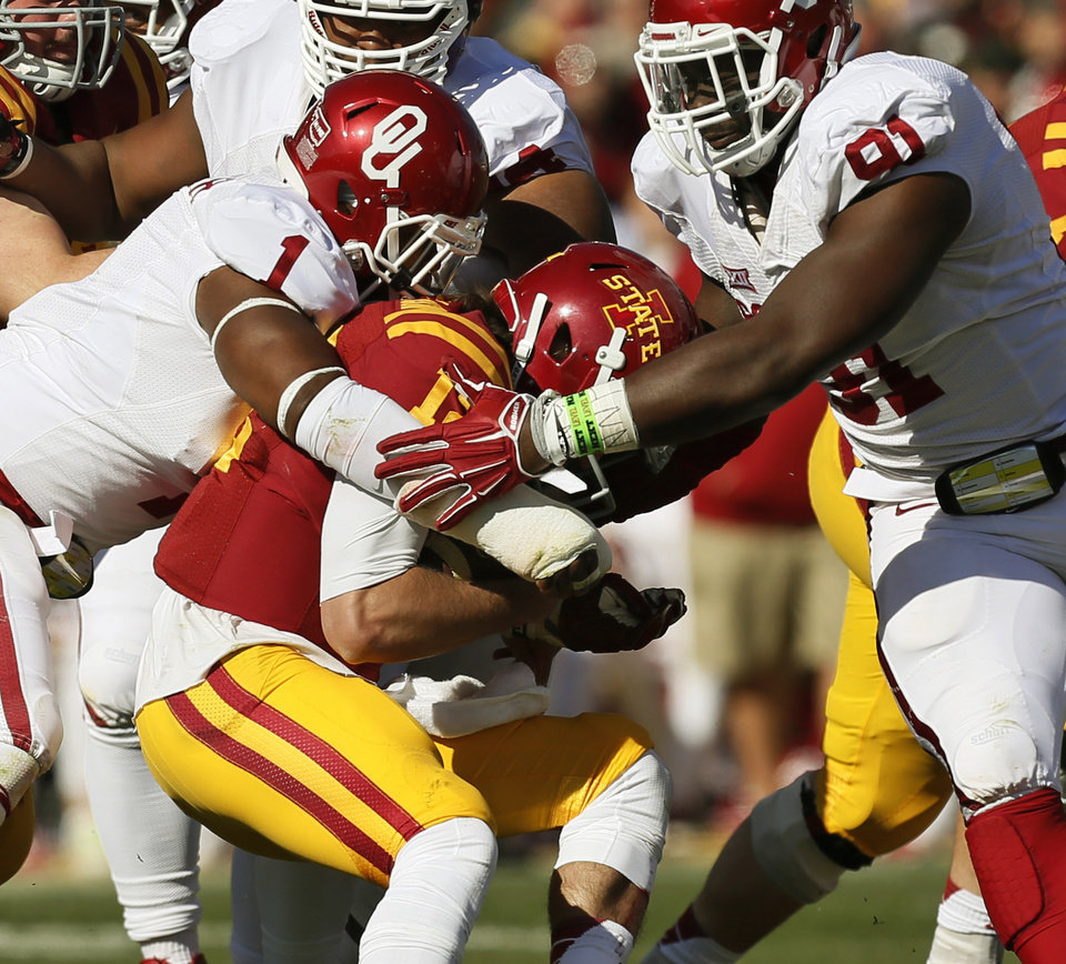 Photo - Oklahoma's Dominique Alexander (1), left, and Charles Tapper (91) stop Iowa State's Sam B. Richardson (12) in the backfield on a keeper in the second quarter during a college football game between the University of Oklahoma Sooners (OU) and the Iowa State Cyclones (ISU) at Jack Trice Stadium in Ames, Iowa, Saturday, Nov. 1, 2014. Photo by Nate Billings, The Oklahoman