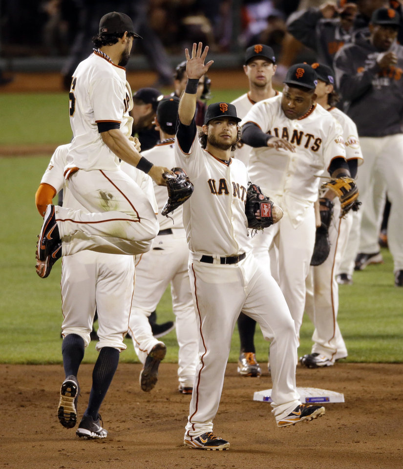 Photo -   San Francisco Giants' Angel Pagan leaps in the air as he celebrates with teammates after Game 2 of baseball's National League championship series against the St. Louis Cardinals Monday, Oct. 15, 2012, in San Francisco. The Giants won 7-1 to ties the series 1-1. (AP Photo/Mark Humphrey)
