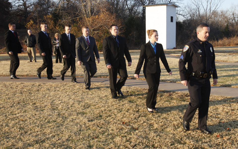 Edmond Police Sgt. Jeff Richardson leads six new cadets as the Edmond Police Department begins its new basic police training academy with ceremonies at the police training center. PHOTO BY PAUL HELLSTERN, THE OKLAHOMAN. <strong>PAUL HELLSTERN - Oklahoman</strong>