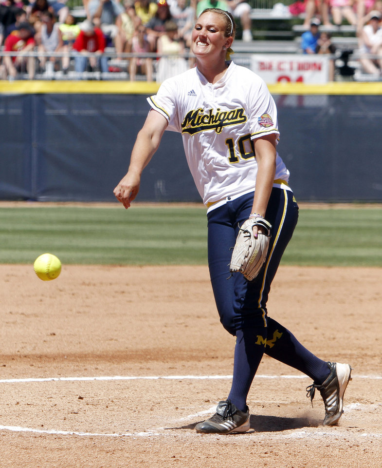 Photo - Michigan Wolverines pitcher Sara Driesenga pitches in the first inning of the Women's College World Series elimination game versus Washington. The Washington Huskies would go on to win 4-1 on June 2, 2013. Photo by KT KING, The Oklahoman