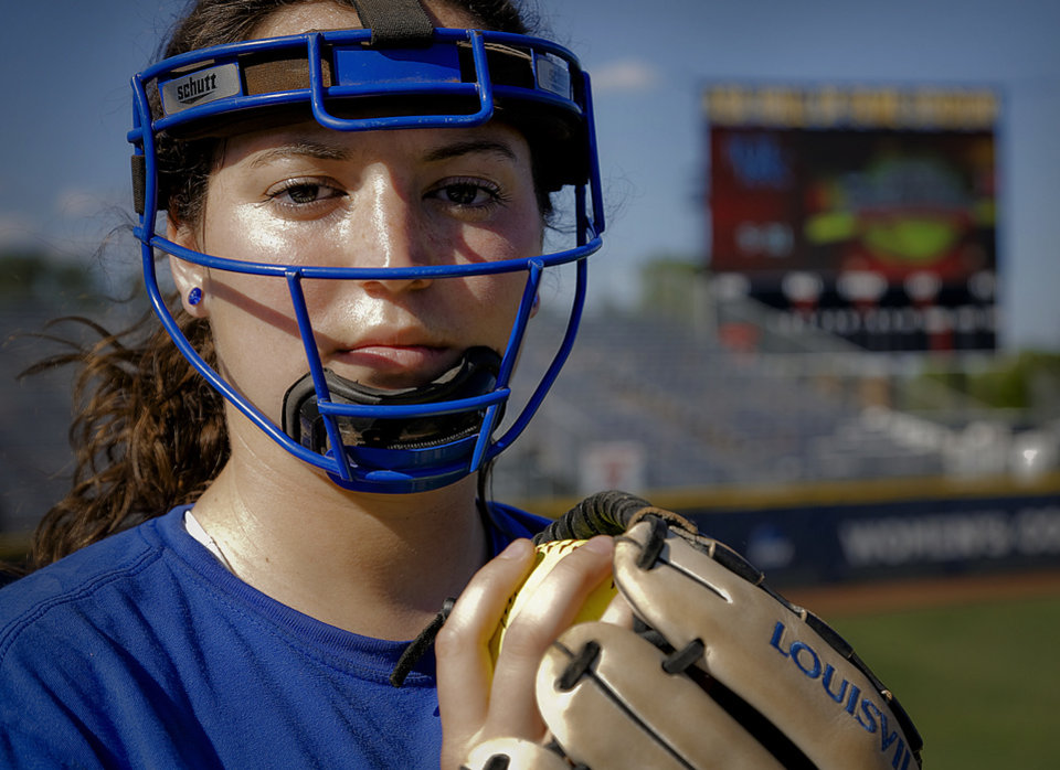 Photo - Kentucky pitcher Kelsey Nunley poses for a photo while wearing her face mask during the Women's College World Series media day at ASA Hall of Fame Stadium on Wednesday, May 28, 2014 in Oklahoma City, Okla.  Photo by Chris Landsberger, The Oklahoman
