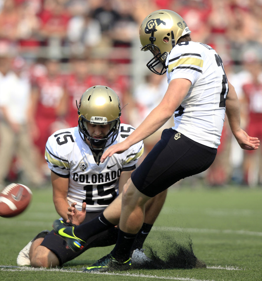 Photo -   Colorado kicker Will Oliver (28) misses a field-goal attempt from the hold of Zach Grossnickle (15) during the first half of an NCAA college football game against Washington State, Saturday, Sept. 22, 2012, at Martin Stadium in Pullman, Wash. (AP Photo/Dean Hare)