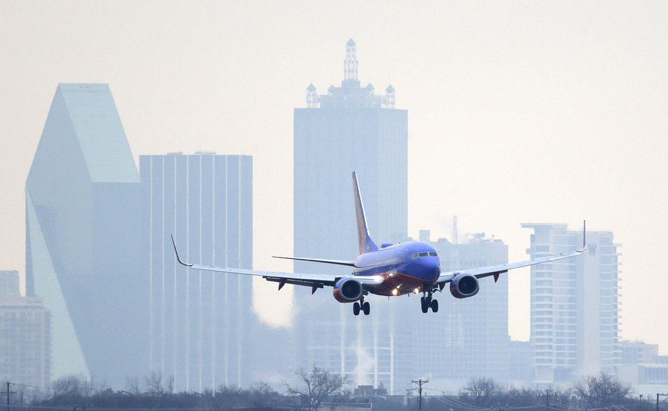Photo - FILE - In this Feb. 3, 2014 file photo, a Southwest Airlines jet plane lines up for a landing at Love Field in Dallas. Southwest Airlines reports quarterly earnings on Thursday, April 24, 2014. (AP Photo/LM Otero, File)