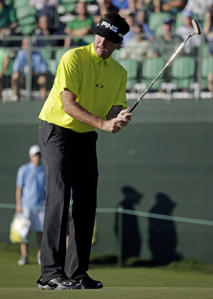 Photo - Bubba Watson misses a birdie putt on the 17th hole during the first round of the Masters golf tournament Thursday, April 10, 2014, in Augusta, Ga. (AP Photo/Chris Carlson)
