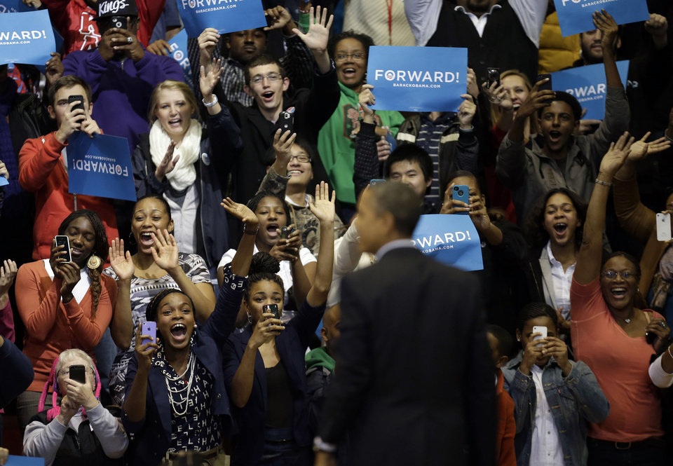 Photo -   Supporters react to seeing President Barack Obama onstage during a campaign event at Fifth Third Arena, Sunday, Nov. 4, 2012, in Cincinnati. (AP Photo/Pablo Martinez Monsivais)