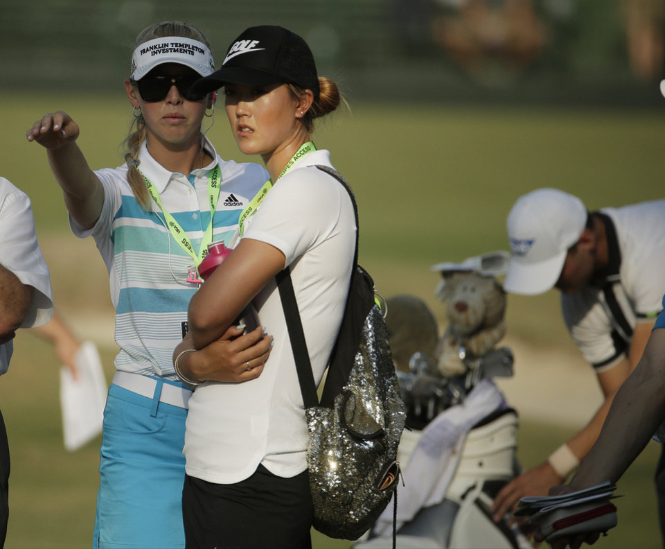 Photo - LPGA players Michelle Wie and Jessica Korda walks with Martin Kaymer, of Germany, right, the last group during the final round of the U.S. Open golf tournament in Pinehurst, N.C., Sunday, June 15, 2014. The women's U.S. Open golf tournament starts Thursday on the same course. (AP Photo/Charlie Riedel)
