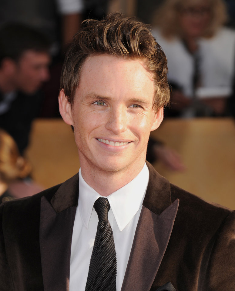 Photo - Actor Eddie Redmayne arrives at the 19th Annual Screen Actors Guild Awards at the Shrine Auditorium in Los Angeles on Sunday, Jan. 27, 2013. (Photo by Jordan Strauss/Invision/AP)