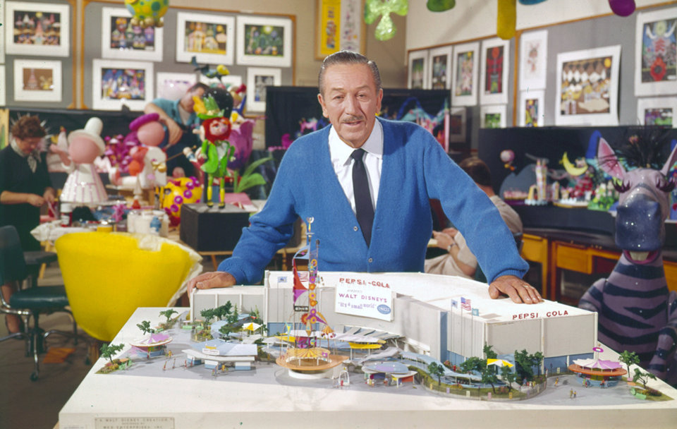 Photo - This 1964 photo released by Disney shows Walt Disney with a model of the
