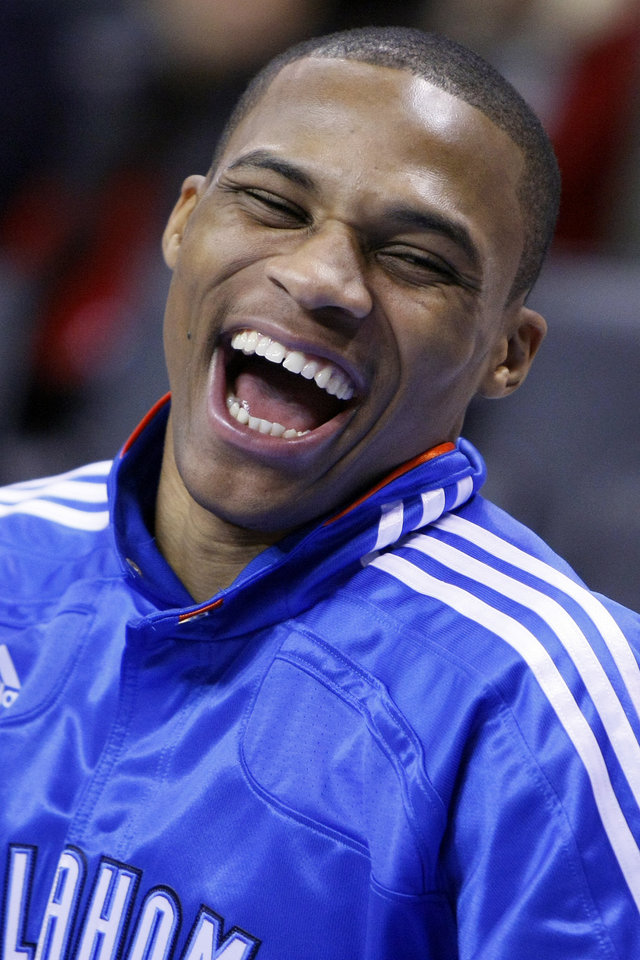 Photo - NBA BASKETBALL/NBA/OKLAHOMA CITY THUNDER/GOLDEN STATE WARRIORS Oklahoma City's Russell Westbrook laughs with teammates before the Thunder - Warriors game Sunday, December 5, 2010 at the Oklahoma City Arena. Photo by Hugh Scott, The Oklahoman ORG XMIT: KOD