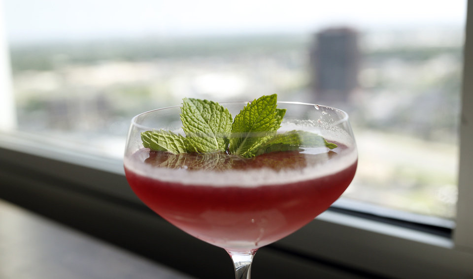 Photo - A cocktail is pictured at the The George Prime Steakhouse in Oklahoma City, Thursday, June 20,  2014. Photo by Sarah Phipps, The Oklahoman