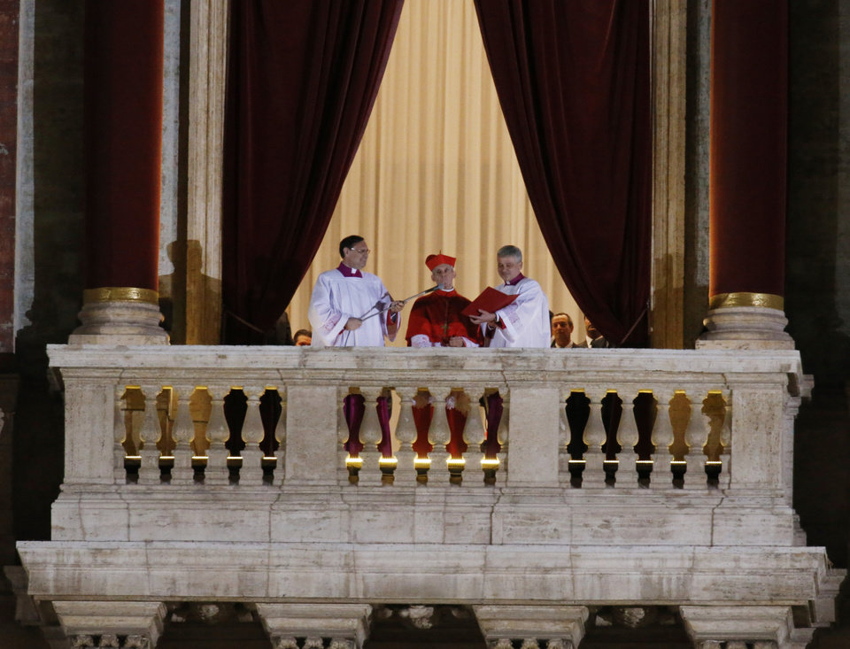 Cardinal Jean-Louis Tauran announces the newly elected Pope Jorge Mario Bergoglio, who took the name of Pope Francis, elected on Wednesday, March 13, 2013 the 266th pontiff of the Roman Catholic Church from the central balcony of St. Peter's Basilica at the Vatican. (AP Photo/Michael Sohn) ORG XMIT: VAT548