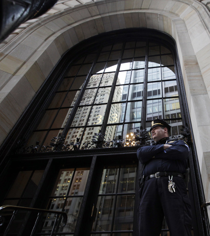 Photo -   A Federal Reserve police officer stands in front of the Federal Reserve Building Wednesday, Oct. 17, 2012, in New York. Federal authorities on Wednesday arrested a Bangladeshi man they said was plotting to blow up the Federal Reserve building in Manhattan, just blocks from the World Trade Center site. Quazi Mohammad Rezwanul Ahsan Nafis, 21, was arrested in a sting operation Wednesday morning after he parked a van filled with what he believed were explosives outside the building and tried to detonate it in a suicide mission, authorities said. (AP Photo/Frank Franklin II)