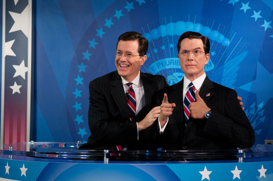 In this photo provided by Madame Tussauds wax museum, Stephen Colbert reacts to seeing his wax figure for the first time at Madame Tussauds in Washington, Friday, Nov. 16, 2012. Colbert helped unveil his wax likeness in the attraction\'s Media Room, which was renovated to include a replica set of The Colbert Report. (AP Photo/Madame Tussauds, Trevor Pound) MANDATORY CREDIT