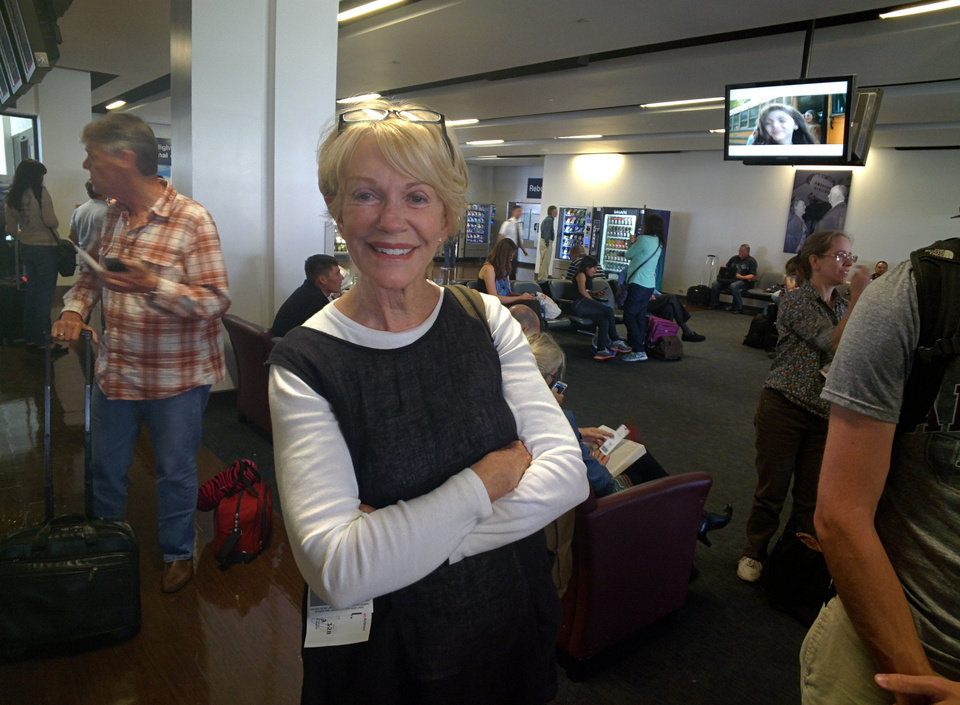Photo - Jane Smith, Edmond, hadn't heard of Glass until others around her noticed it in the Los Angeles airport right before boarding a plane bound for Oklahoma City. PHOTO BY LILLIE-BETH BRINKMAN, THE OKLAHOMAN.