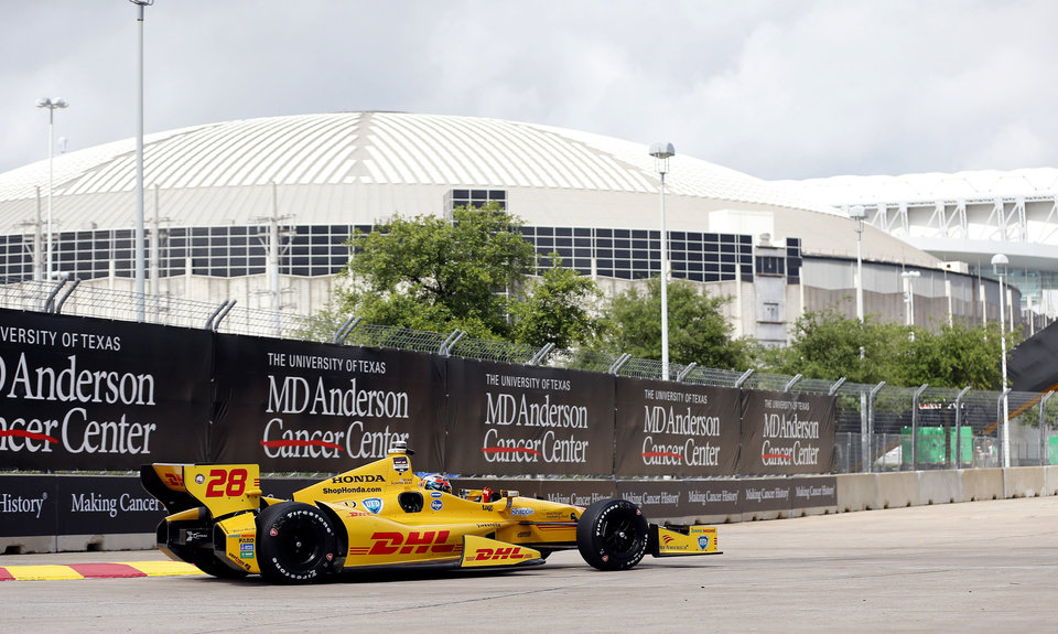 Photo - Ryan Hunter-Reay drives near the Astrodome during a practice session for the IndyCar Grand Prix of Houston auto race Friday, June 27, 2014, in Houston. (AP Photo/David J. Phillip)