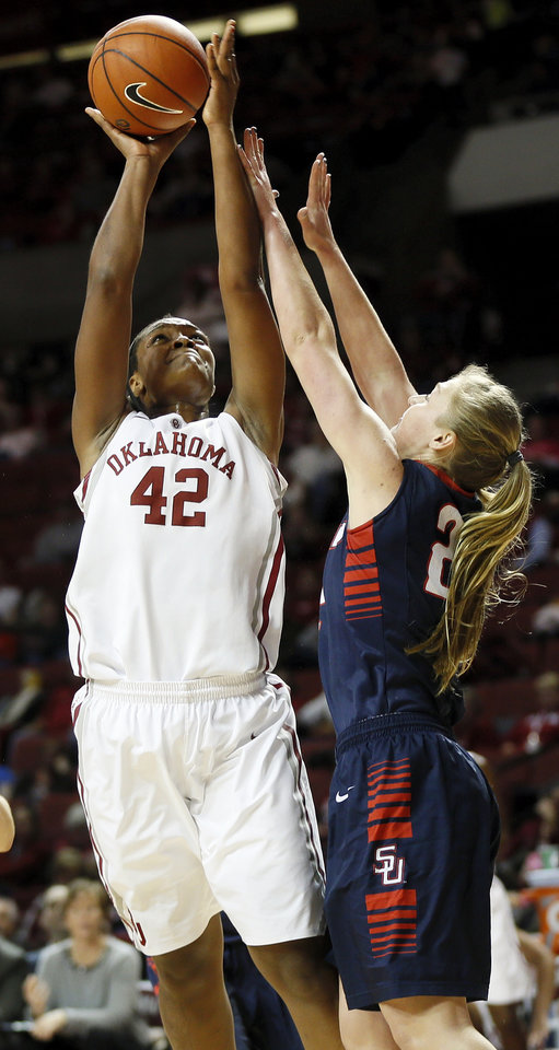 Photo - Oklahoma's Kaylon Williams (42) shoots against Samford's Ellen Riggins (22) during a women's college basketball game between the University of Oklahoma Sooners and the Samford Bulldogs at Lloyd Noble Center in Norman, Okla., Sunday, Dec. 29, 2013. OU won, 66-35. Photo by Nate Billings, The Oklahoman