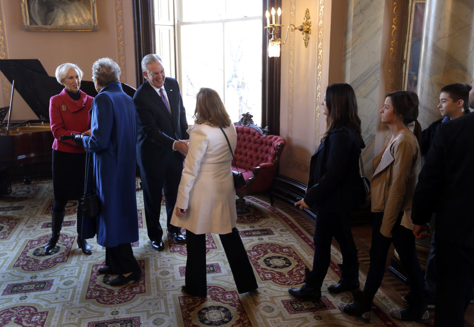 Missouri Gov. Jay Nixon greets visitors to the governor's mansion along side First Lady Georganne Nixon, left,  after being sworn in to a second term Monday, Jan. 14, 2013, in Jefferson City, Mo. (AP Photo/Jeff Roberson)