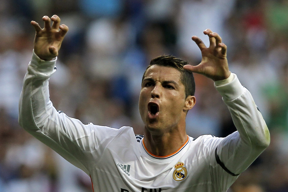 Photo - Real Madrid's Cristiano Ronaldo from Portugal celebrates his goal during a Spanish La Liga soccer match against Getafe at the Santiago Bernabeu stadium in Madrid, Spain, Sunday, Sept. 22, 2013. (AP Photo/Andres Kudacki)