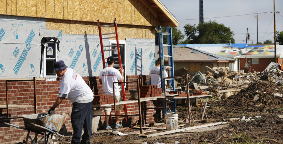 Photo - This home  at 113 SW 8 in Moore is being rebuilt by a volunteer nonprofit organization from Virginia called Operation Blessing. The home was destroyed by the May 20 tornado that hit Moore. PHOTO BY JIM BECKEL, THE OKLAHOMAN  Jim Beckel - THE OKLAHOMAN