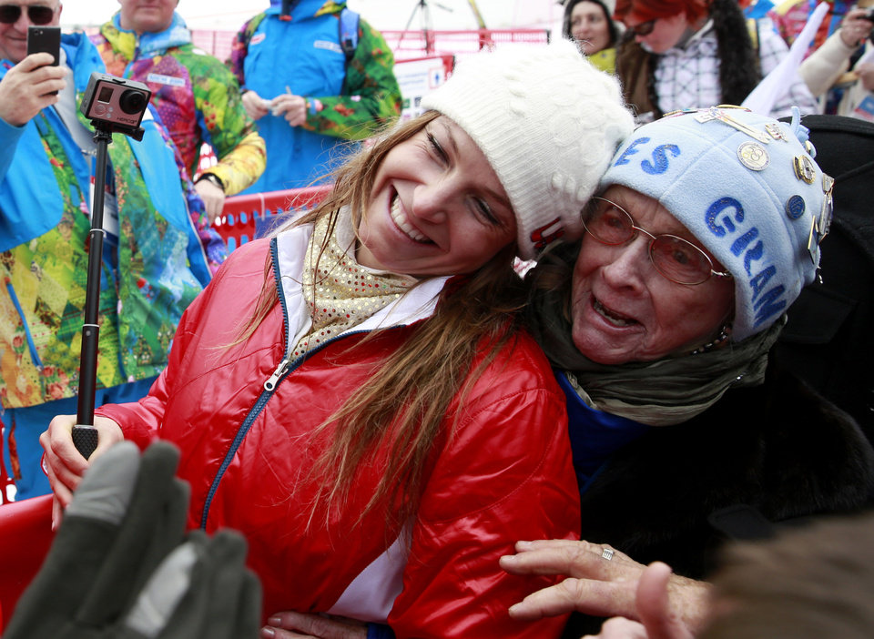 Photo - Women's supercombined bronze medal winner United States' Julia Mancuso and her grandmother Sheila Tuffanelli  are surrounded by well-wishers at the Alpine ski venue at the Sochi 2014 Winter Olympics, Monday, Feb. 10, 2014, in Krasnaya Polyana, Russia. (AP Photo/Gero Breloer)