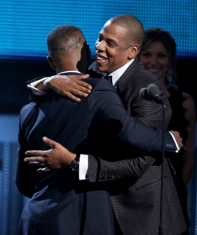 Photo - Jamie Foxx, left, presents Jay-Z with the award for best rap/sung collaboration at the 56th annual Grammy Awards at Staples Center on Sunday, Jan. 26, 2014, in Los Angeles. (Photo by Matt Sayles/Invision/AP)