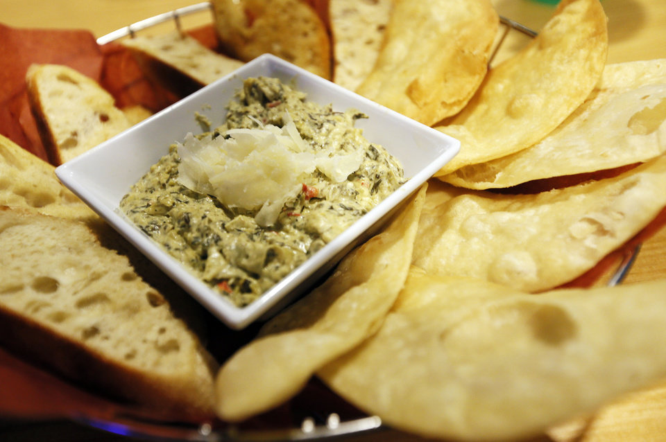 Photo - Warm Spinach Artichoke Dip at Jack Daniels Old No. 7 Club before an NBA basketball game between the Oklahoma City Thunder and the Milwaukee Bucks at Chesapeake Energy in Oklahoma City, Wednesday, April 17, 2013. Photo by Nate Billings, The Oklahoman