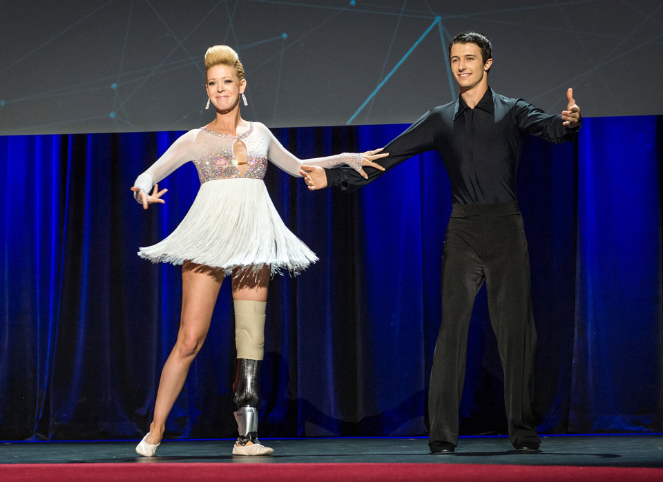Photo - In this photo provided by TED 2014 Conference, dancer Adrianne Haslet-Davis, left, performs on stage with dancer Christian Lightner at the 2014 TED Conference, Wednesday, March 19, 2014, in Vancouver, British Columbia. Haslet-Davis took to the stage with a new prosthetic limb to perform for the first time since losing part of her left leg in the 2013 Boston Marathon bombing. (AP Photo/TED 2014 Conference, James Duncan Davidson)