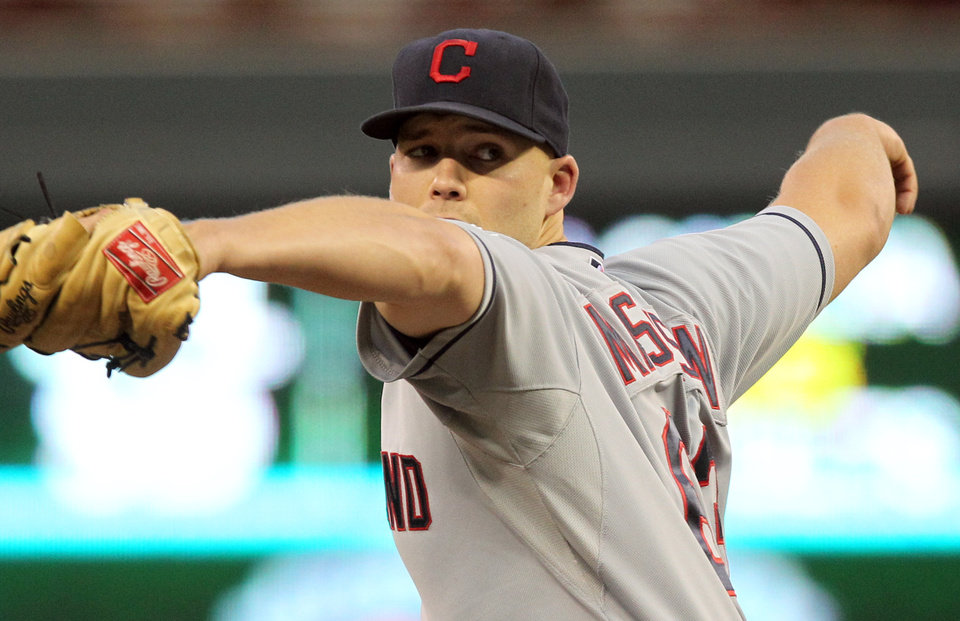 Photo -   Cleveland Indians starting pitcher Justin Masterson (63) throws against the Minnesota Twins during the first inning of a baseball game, Monday, Sept. 10, 2012, in Minneapolis. (AP Photo/Genevieve Ross)
