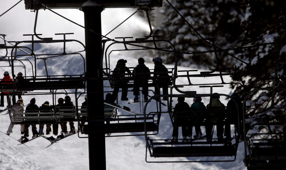 Photo -   This Nov. 13, 2012 photo shows skiers riding a chair lift line at Brighton Ski Resort in the Wasatch Range, in Utah. The Brighton Ski Resort is in middle of the Wasatch Range's 7 resorts. If the resorts were to be combined, the Utah resorts could offer North America's largest skiing complex _ three times the size of Vail and twice as big as Whistler Blackcomb in British Columbia. (AP Photo/Rick Bowmer)