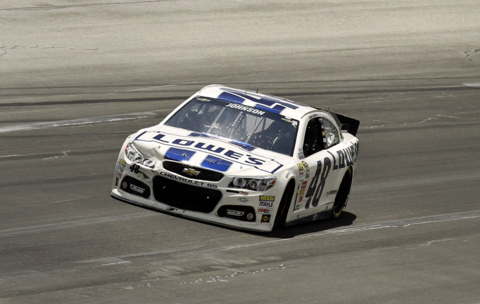 Photo - Jimmie Johnson cruises out of Turn 3 well in front of the rest of the field in the NASCAR Sprint Cup auto race at Kentucky Speedway in Sparta, Ky., Sunday, June 30, 2013.  (AP Photo/Garry Jones)