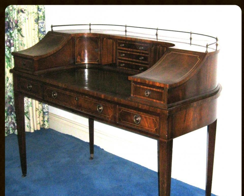 Photo -  The Walsh estate includes this Federal-style mahogany secretary with gallery, pigeonholes and tooled leather top. PHOTO PROVIDED