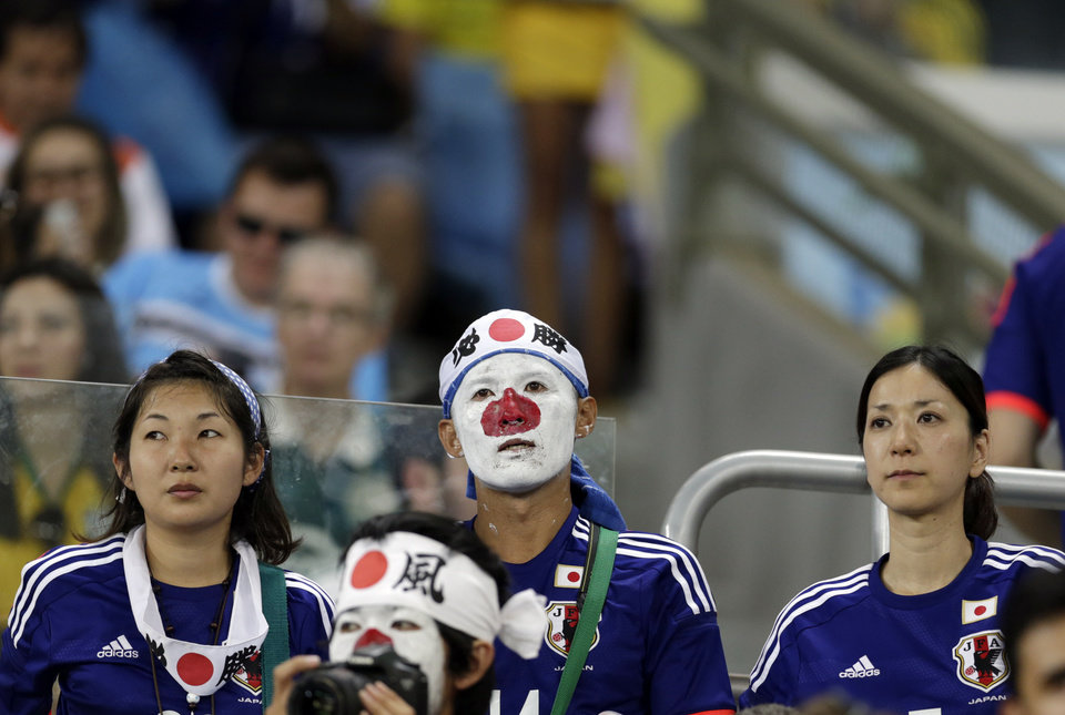 Photo - Japan's fans react at the end of the group C World Cup soccer match between Japan and Colombia at the Arena Pantanal in Cuiaba, Brazil, Tuesday, June 24, 2014. Colombia won 4-1.(AP Photo/Dolores Ochoa)