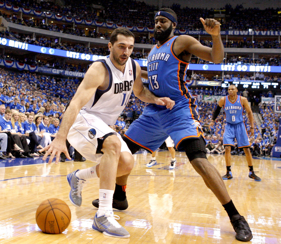 Oklahoma City\'s James Harden (13) defends Peja Stojakovic (16) of Dallas during game 2 of the Western Conference Finals in the NBA basketball playoffs between the Dallas Mavericks and the Oklahoma City Thunder at American Airlines Center in Dallas, Thursday, May 19, 2011. Photo by Bryan Terry, The Oklahoman