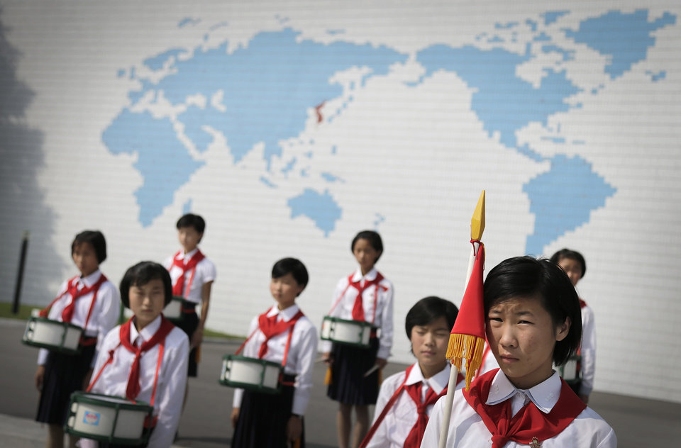 Photo - North Korean school girls stand in formation during an opening ceremony for the start of summer activities at the Songdowon International Children's Camp, Tuesday, July 29, 2014, in Wonsan, North Korea. The camp, which has been operating for nearly 30 years, was originally intended mainly to deepen relations with friendly countries in the Communist or non-aligned world. But officials say they are willing to accept youth from anywhere - even the United States. (AP Photo/Wong Maye-E)
