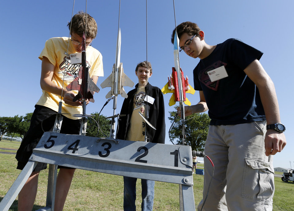 Photo -  Alex Privett, Alex Marshall and Alex Konieczny, all 16, prepare to launch their rockets June 11 at Sooner Flight Academy in Norman.  Photos by Steve Sisney, The Oklahoman    STEVE SISNEY  -  THE OKLAHOMAN