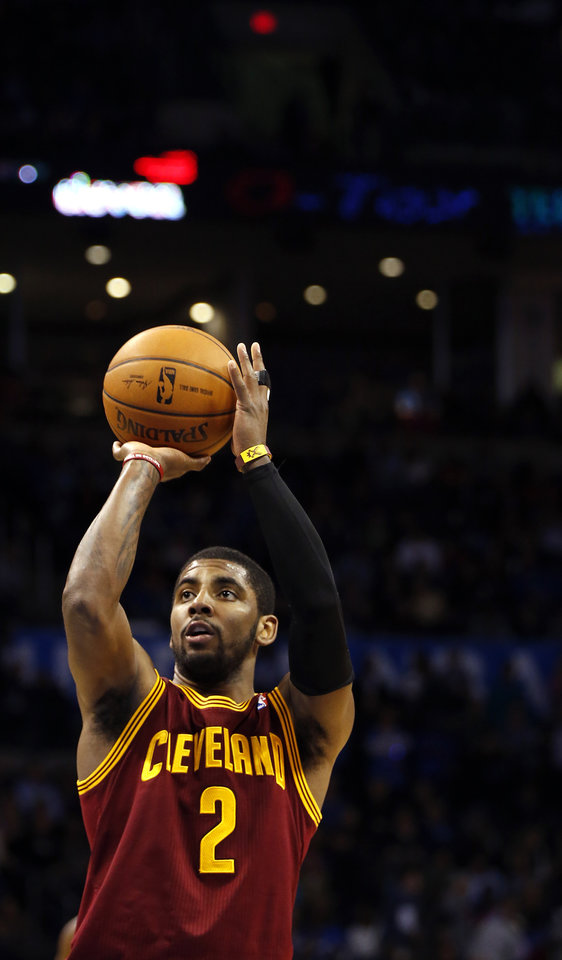 Photo - Cleveland's Kyrie Irving (2) puts up a shot during the NBA basketball game between the Oklahoma City Thunder and the Cleveland Cavaliers at the Chesapeake Energy Arena in Oklahoma City, Okla. on Wednesday, Feb. 26, 2014.  Photo by Chris Landsberger, The Oklahoman