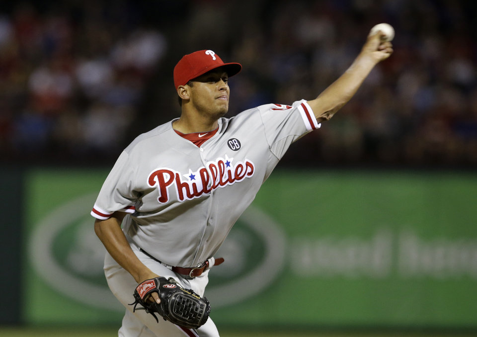 Photo - Philadelphia Phillies relief pitcher Mario Hollands works against the Texas Rangers in the ninth inning of a baseball game, Tuesday, April 1, 2014, in Arlington, Texas. Hollands made his major league debut in the 3-2 Rangers win. (AP Photo/Tony Gutierrez)